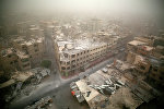 Общий вид поврежденных зданий в Думе, к востоку от столицы Дамаска. 7 сентября 2015.