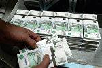 Нацбанк: ЛНР проводит безналичные платежи в рублях через Южную Осетию
