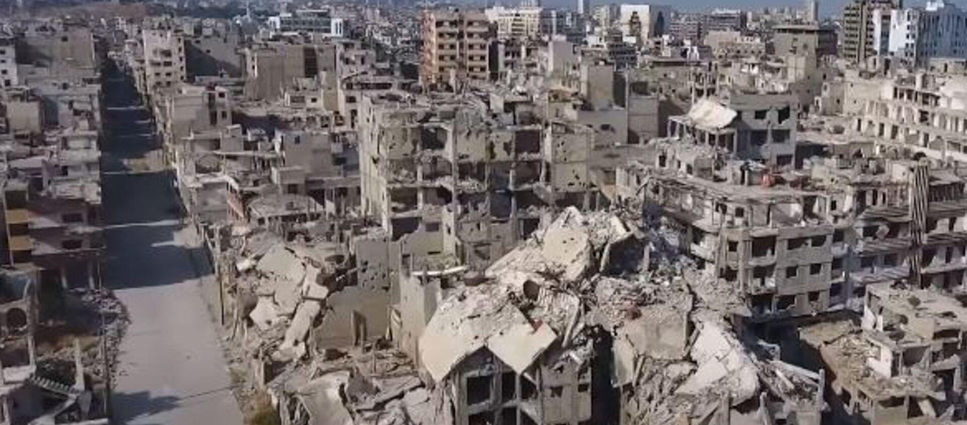 Беспилотник заснял разрушенный Хомс в десятую годовщину начала войны в Сирии - Sputnik Абхазия, 1920, 16.03.2021