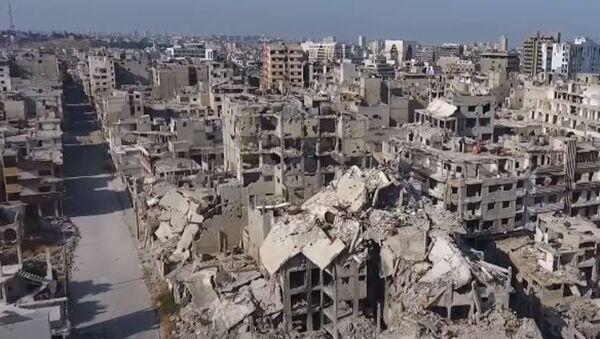 Беспилотник заснял разрушенный Хомс в десятую годовщину начала войны в Сирии - Sputnik Абхазия