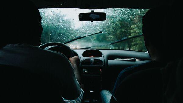 Человек за рулем автомобиля   - Sputnik Абхазия