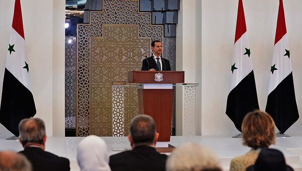 Раздаточный материал, опубликованный на официальной странице президентства Сирии в Facebook, показывает, что президент Башар аль-Асад выступает с речью - Sputnik Аҧсны