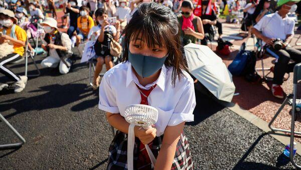 Люди на мероприятии torch kiss в Токио  - Sputnik Абхазия