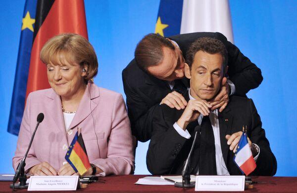 Президент Франции Николя Саркози, канцлер Германии Ангела Меркель и премьер-министр Италии Сильвио Берлускони в Париже. - Sputnik Абхазия