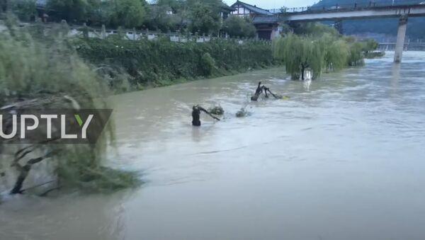 Китай: кадры с беспилотника показывают степень разрушения во время наводнения в Ланчжун  - Sputnik Абхазия