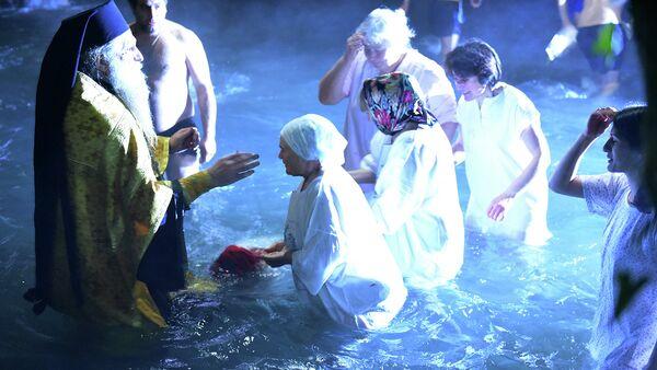 Праздник Крещения в селе Каман. Фото с места события. - Sputnik Абхазия