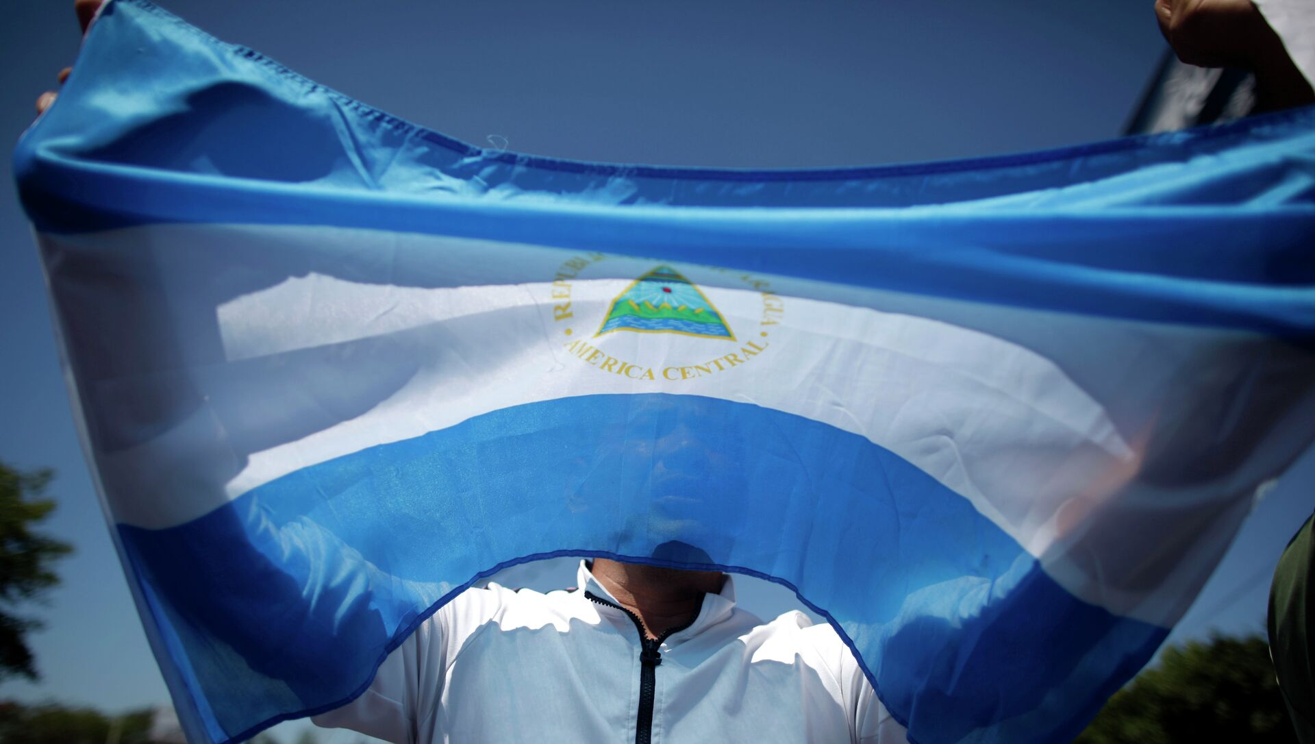 Флаг Республики Никарагуа. Архивное фото. - Sputnik Аҧсны, 1920, 15.09.2021