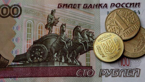 Денежные купюры и монеты России и Украины - Sputnik Абхазия