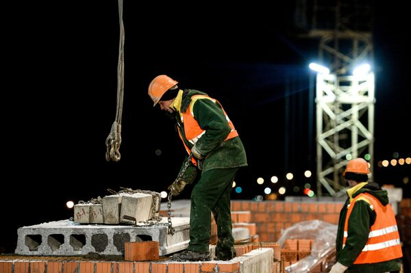 Рабочие на стройке. - Sputnik Абхазия