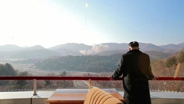 Лидер КНДР Ким Чен Ын на космодроме Сохэ. - Sputnik Абхазия