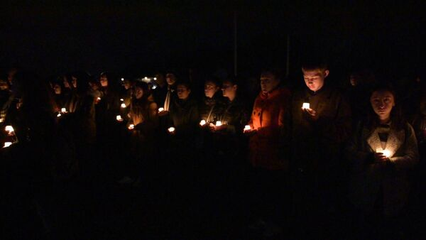 В память о погибших в Мартовском наступлении зажгли 222 свечи - Sputnik Абхазия