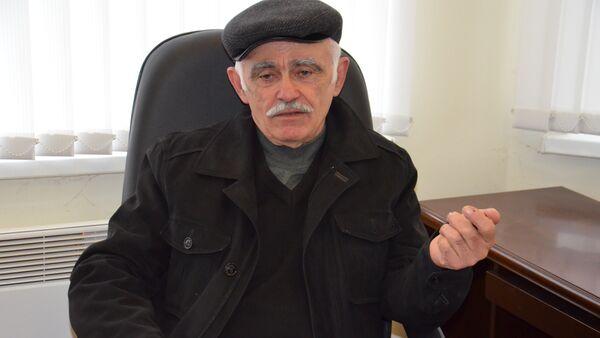 Архивное фото заместителя директора по науке НИИ Сельского хозяйства Абхазии Федора Тарба - Sputnik Абхазия