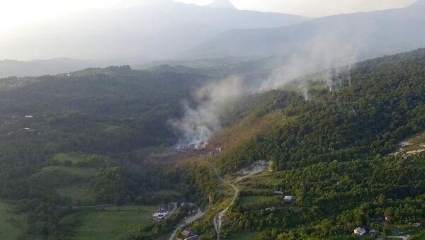 Взрыв на складе боеприпасов в Приморском: кадры с беспилотника - Sputnik Абхазия