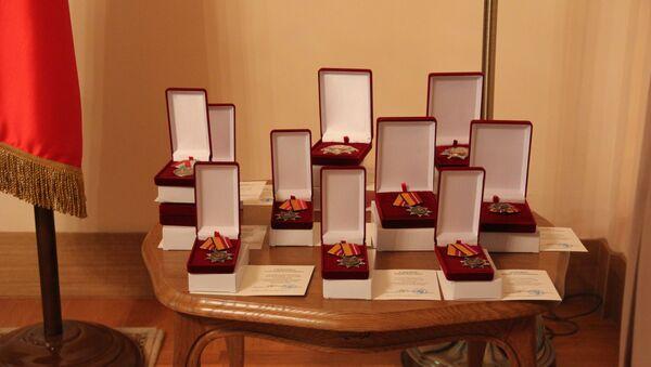 Посол Абхазии вручил правительственные награды бойцам Рижского ОМОНа - Sputnik Абхазия