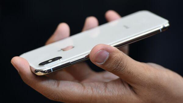 Новый iPhone X показан во время медиа-мероприятия в новом офисе Apple в Купертино, Калифорния - Sputnik Абхазия