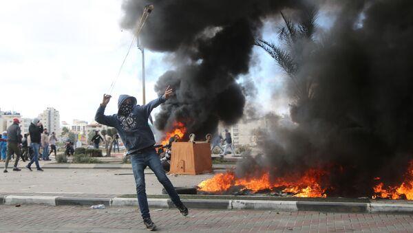 Участник акции протеста в Палестине против решения о признании Иерусалима столицей Израиля - Sputnik Абхазия