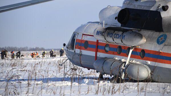 Вертолет МЧС России в Раменском районе Московской области, где самолет Ан-148 Саратовских авиалиний рейса 703 Москва-Орск потерпел крушение 11 февраля 2018 года - Sputnik Абхазия