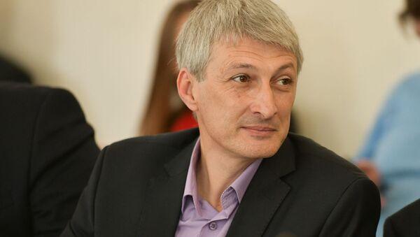 Депутат Илья Гуния на первом заседании весенней сессии парламента Абхазии шестого созыва - Sputnik Аҧсны