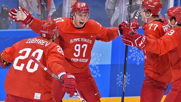 Игроки сборной России радуются победе в финальном матче Россия - Германия Олимпийских игр-2018 - Sputnik Аҧсны
