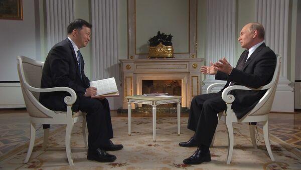 Владимир Путин дал интервью китайскому телевидению - Sputnik Абхазия