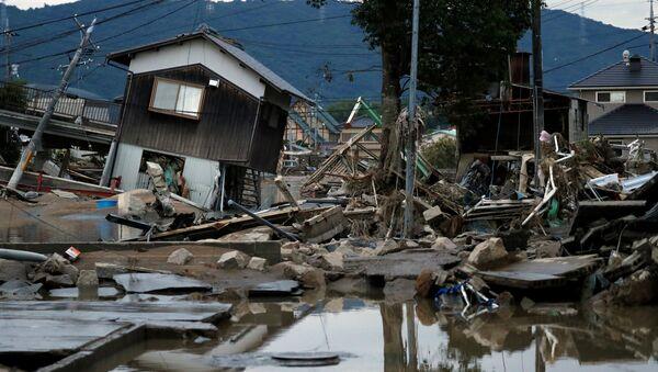 Разрушенные дома в затопленном районе в Курасики, Япония, 8 июля 2018 года - Sputnik Аҧсны