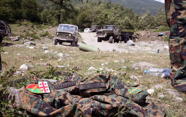 Picture taken on August 12, 2008 shows an abandoned Georgian uniform  on the ground in the remote Kodori Gorge of Georgia's breakaway Abkhazia region in the town of Chkhalta. Abkhaz separatist soldiers drove Georgian forces out of Chkhalta and took control of the town. The leaders of two Russian-backed rebel regions, South Ossetia and Abkhazia, ruled out talks with Georgia's leaders, accusing them of war crimes, Interfax news agency reported.             AFP PHOTO / STR / AFP PHOTO / STR - Sputnik Абхазия