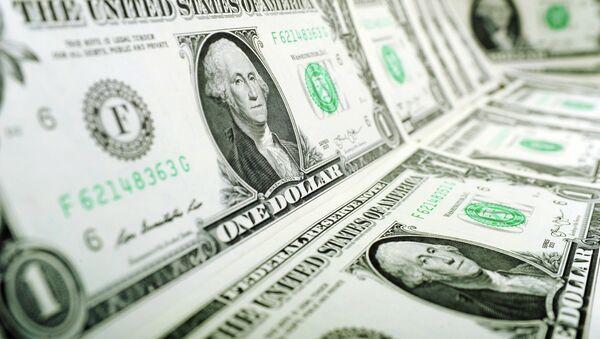 Банкноты номиналом 1 доллар США. - Sputnik Абхазия