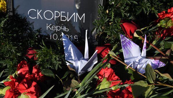 Акции памяти о погибших при нападении на колледж в Керчи - Sputnik Абхазия