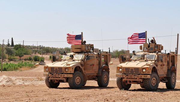 Американские военнослужащие в районе населенного пункта Манбидж, Сирия. Архивное фото - Sputnik Абхазия