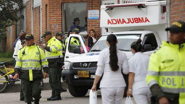 Сотрудники полиции и скорой помощи в Боготе, Колумбия. Архивное фото - Sputnik Абхазия