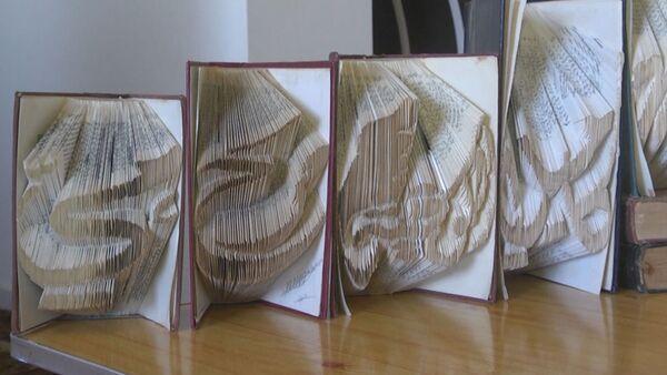 Житель сектора Газа делает оригами из старых книг - Sputnik Абхазия