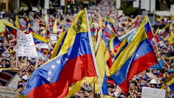 Акция в поддержку лидера оппозиции Х. Гуаидо в Каракасе - Sputnik Аҧсны