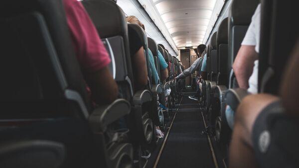 Пассажиры в самолете - Sputnik Абхазия