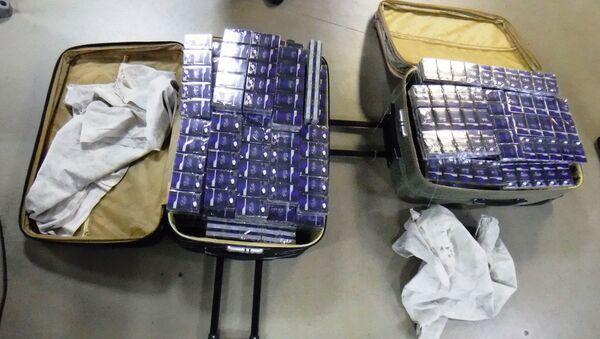 120 блоков табачных изделий без акцизных марок (1200 пачек, 24 000 штук).   - Sputnik Абхазия
