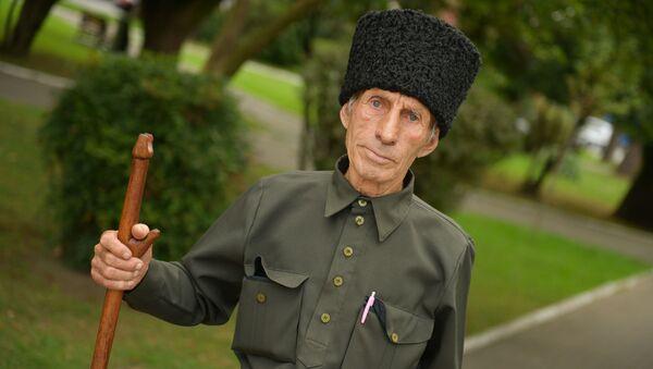 Восьмидесятилетний житель села Блабырхуа Хирбей Барциц - Sputnik Абхазия