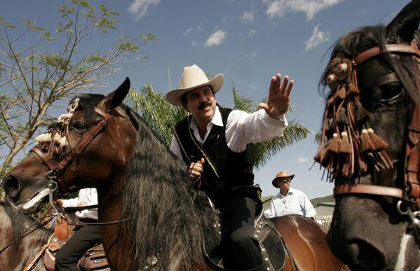 Президент Гондураса Мануэль Селайя во время традиционного конного парада в его честь в Пальмаресе,  к северо-западу от столицы Сан-Хосе, Коста-Рика - Sputnik Абхазия