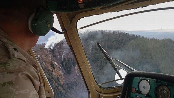 Вертолет МЧС Абхазии производит облет территории  - Sputnik Аҧсны