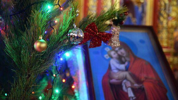 Во время рождественского богослужения в храме Михаила Архангела в Грозном - Sputnik Аҧсны