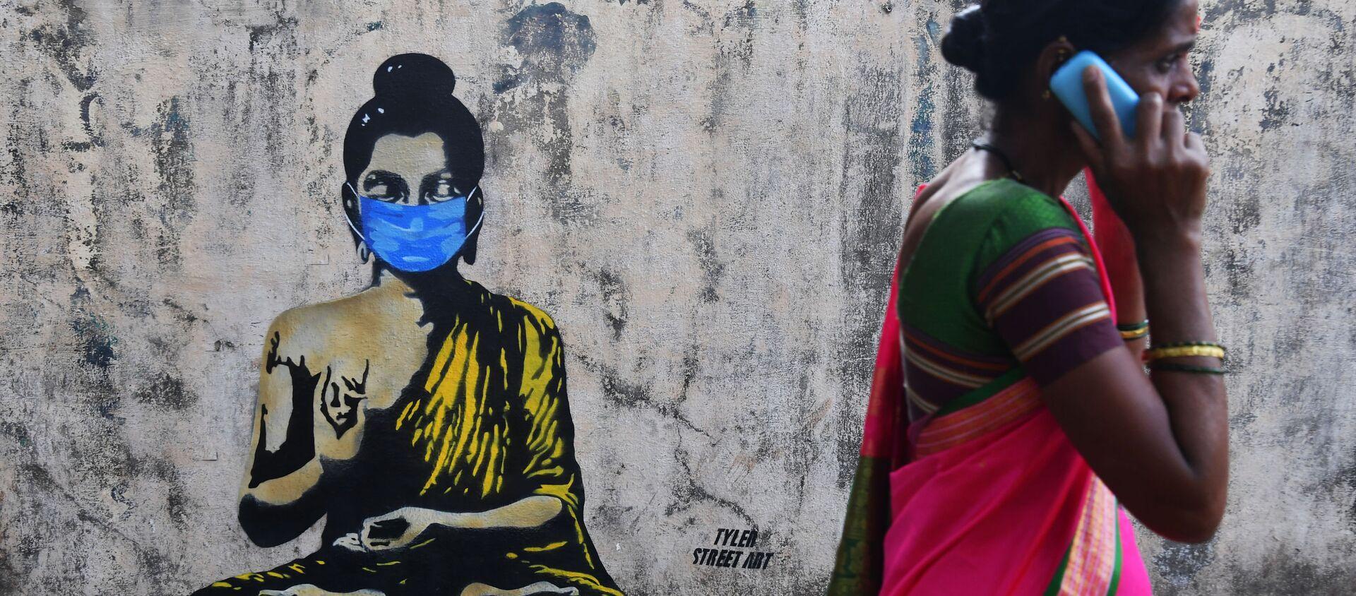 Будда в защитной маске на граффити в Мумбае - Sputnik Абхазия, 1920, 01.05.2020