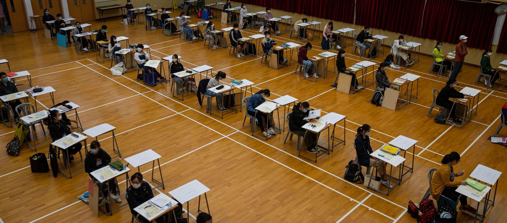 Студенты во время сдачи экзамена в Гонконге, Китай - Sputnik Аҧсны, 1920, 24.07.2020