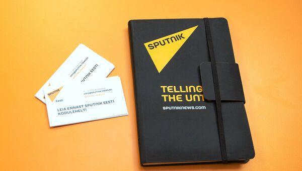 Блокнот с символикой информационного агентства Sputnik. - Sputnik Аҧсны